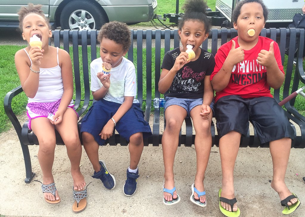 Four kids eat ice cream